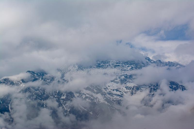 Mountain covered with clouds and fog at Mardi Himal trek in Himalayas stock images