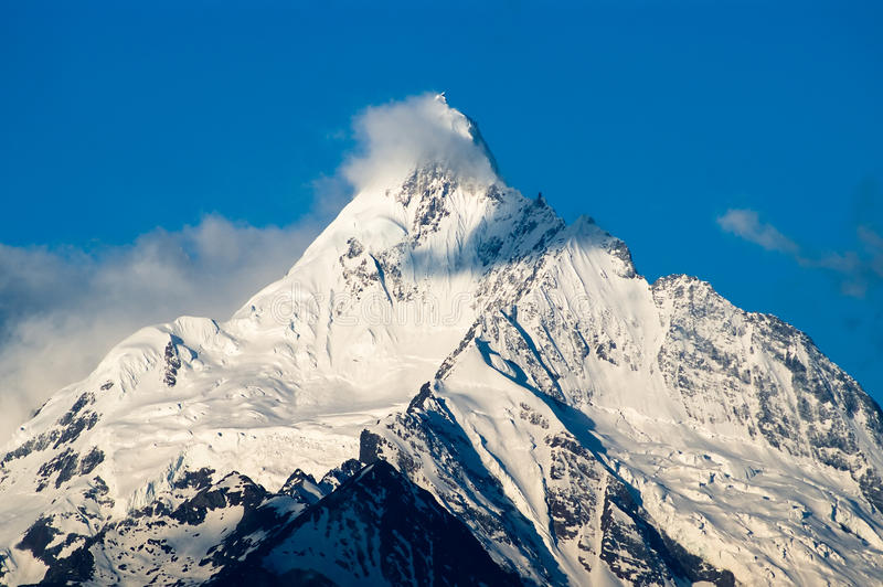 Mountain covered with snow stock photography