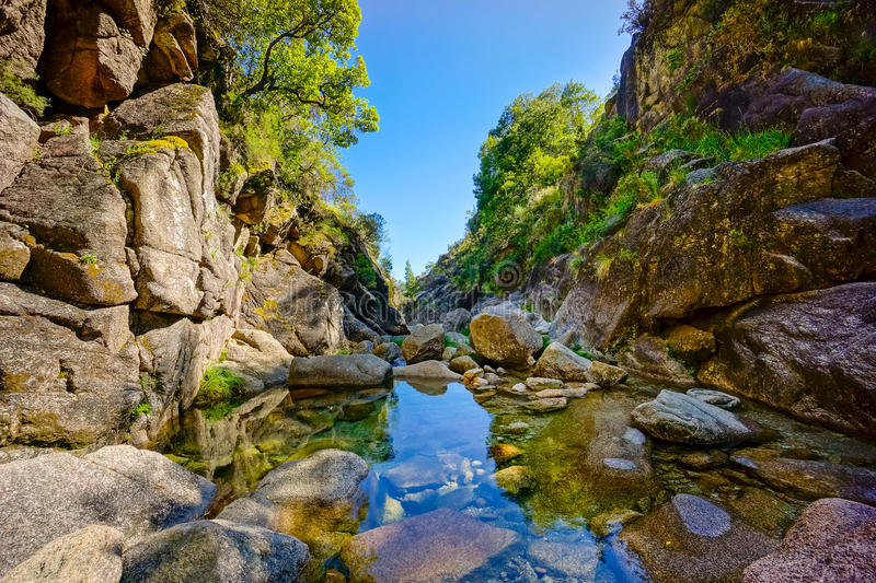 Mountain creek in Geres stock images