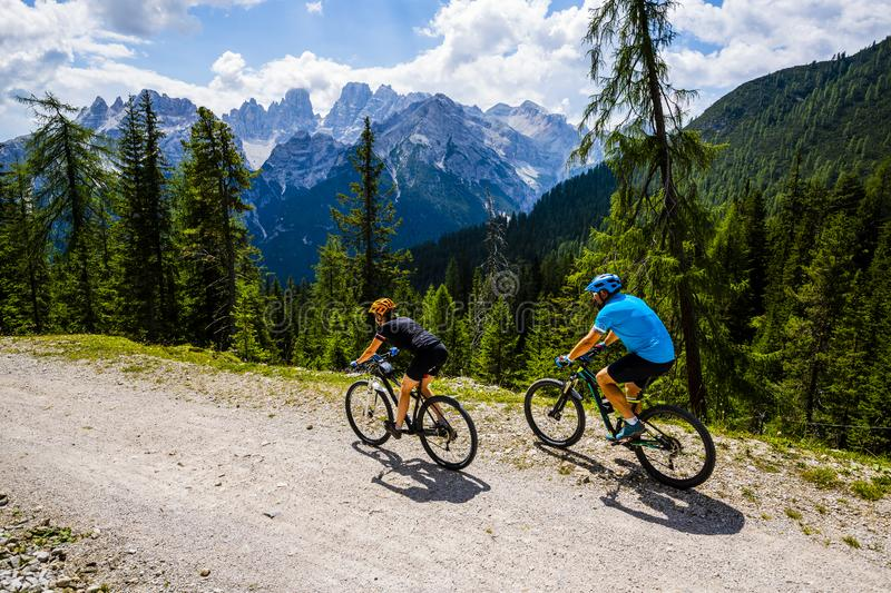 Mountain cycling couple with bikes on track. royalty free stock photo