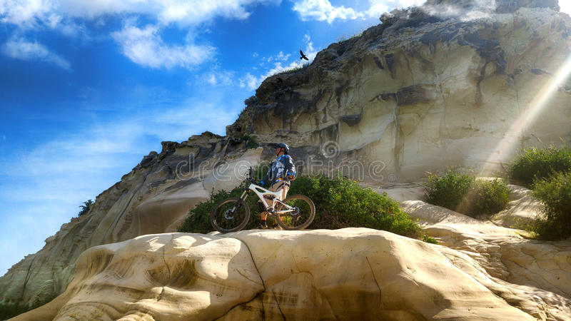 Mountain cyclist admires the views from the historic mountain. Of Tel Zafit (Gath of the Philistines stock photo