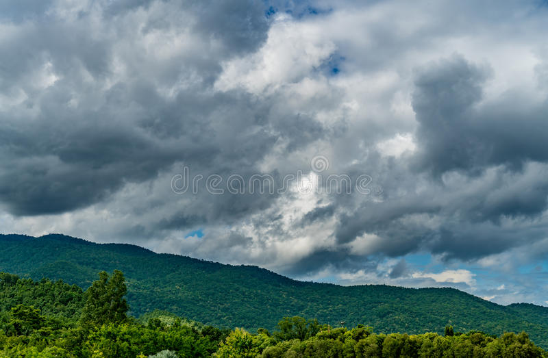 Mountain with dark cloud stock image