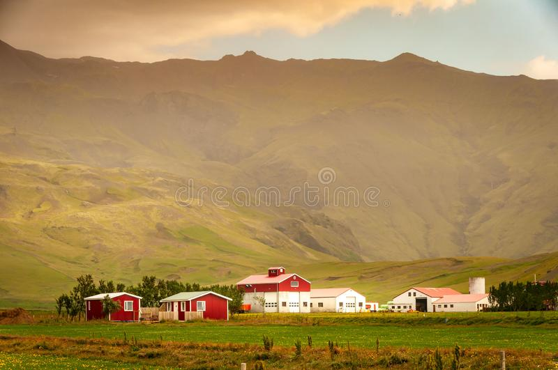 Mountain Farm. In Iceland. Colorful buildings. beautiful landscape in an agricultural setting stock images