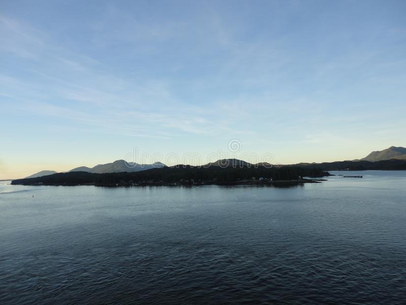 Mountain Filled horizon on the pacific ocean. Inside passage Alaska at sunset stock photos