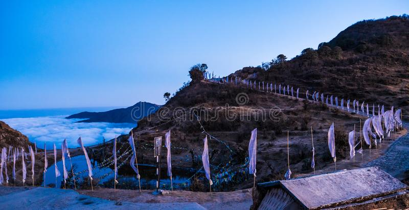 Mountain Peace  flags  on  top  of mountain. Mountain peace  flags  on  top  of  mountain  near  west  bengal  on  trek  to  sandakphu royalty free stock photo