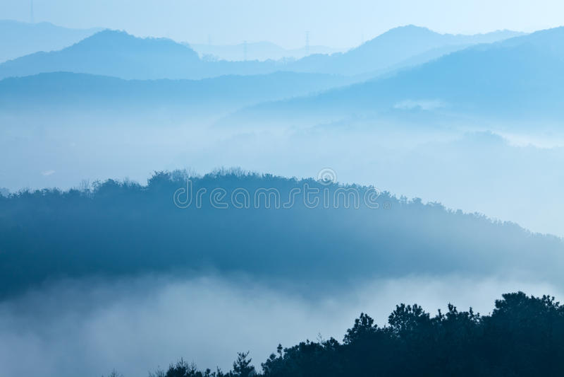 Mountain in fog royalty free stock photos