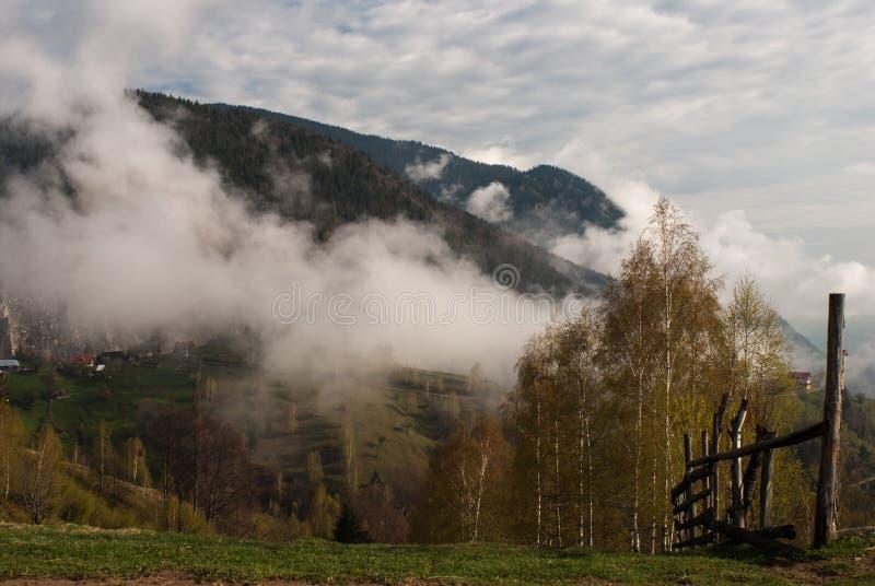 Mountain fog fence royalty free stock image