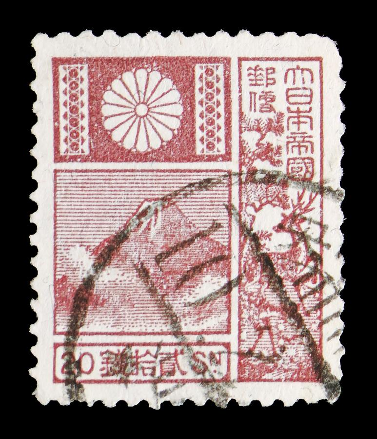 Mountain Fuji and Deer - Violet, New Die serie, circa 1931. MOSCOW, RUSSIA - JULY 19, 2019: Postage stamp printed in Japan shows Mountain Fuji and Deer - Violet stock photo