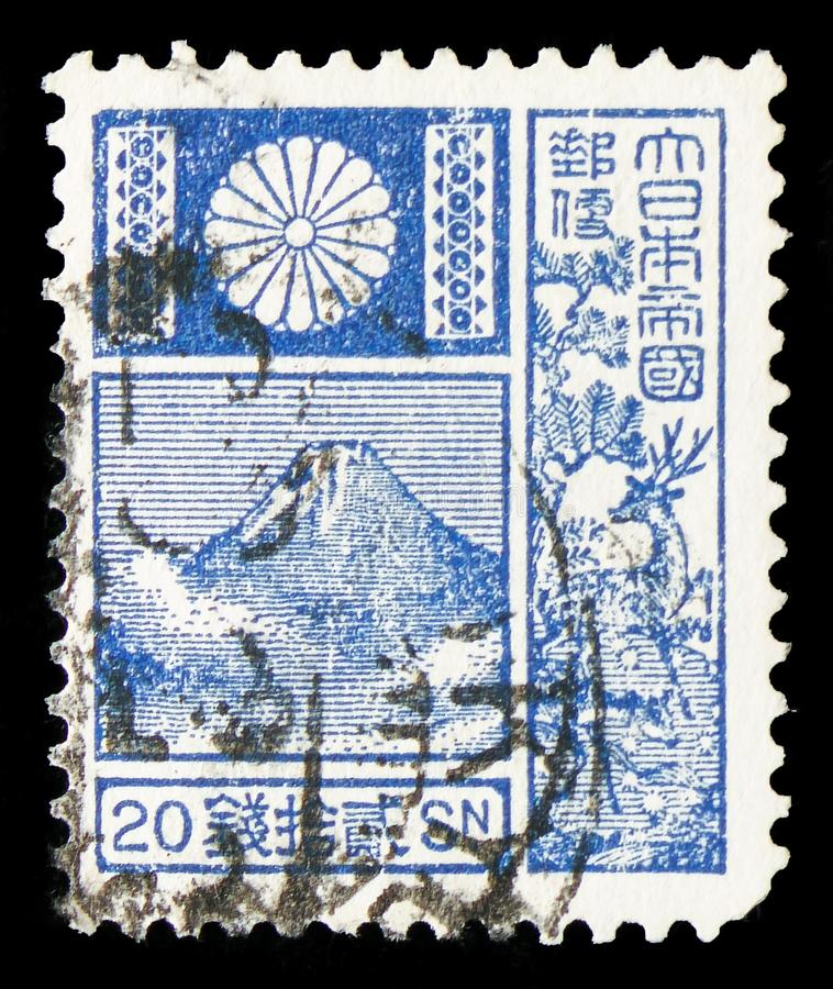 Mountain Fuji and Deer - Violet, New Die serie, circa 1937. MOSCOW, RUSSIA - JULY 19, 2019: Postage stamp printed in Japan shows Mountain Fuji and Deer - blue stock photography