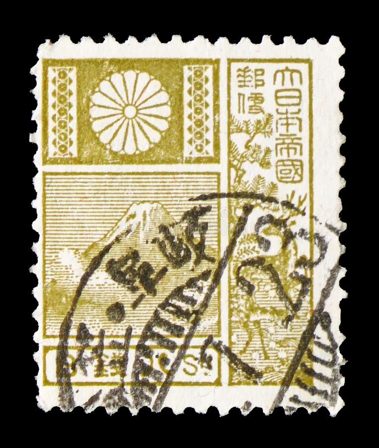 Mountain Fuji and Deer - Violet, New Die serie, circa 1937. MOSCOW, RUSSIA - JULY 19, 2019: Postage stamp printed in Japan shows Mountain Fuji and Deer - Olive royalty free stock photos