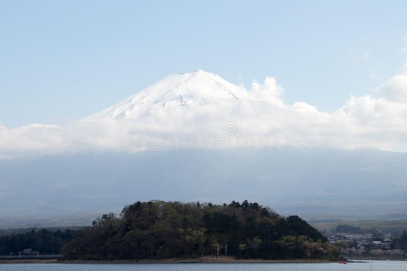 Mountain Fuji with snow cap as background and lake kawaguchiko as foreground. stock photos