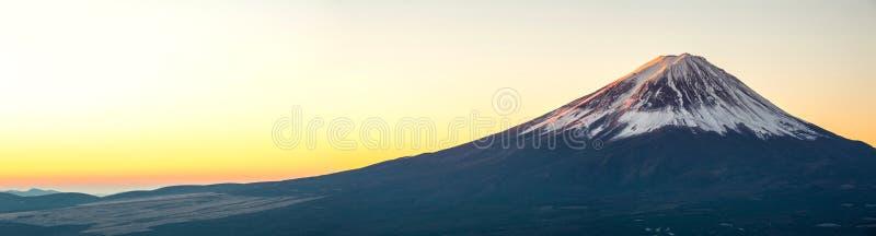 Mountain Fuji sunrise Japan panorama. Mountain Fuji in winter sunrise panorama stock photo