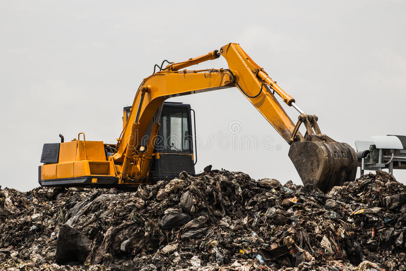 Mountain of garbage with working royalty free stock image