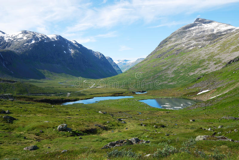 Mountain gentle slope with small lakes. Norway. stock photo