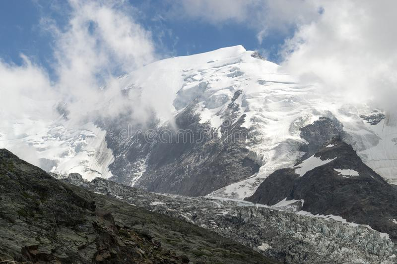 Mountain glacier in the summertime stock images