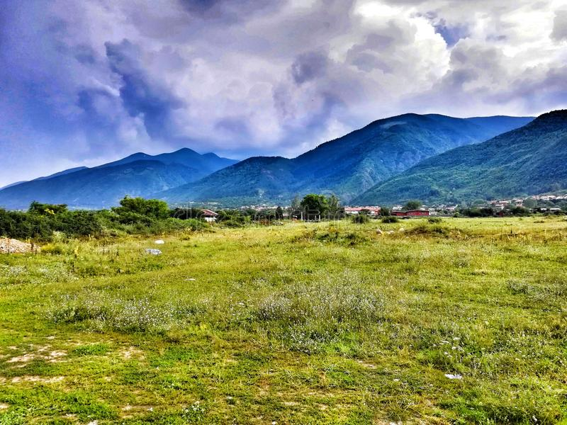 Mountain, nature, Dupnitsa. Mountain, grass, sky, clouds, nature, Dupnitsa, Bulgaria stock photos