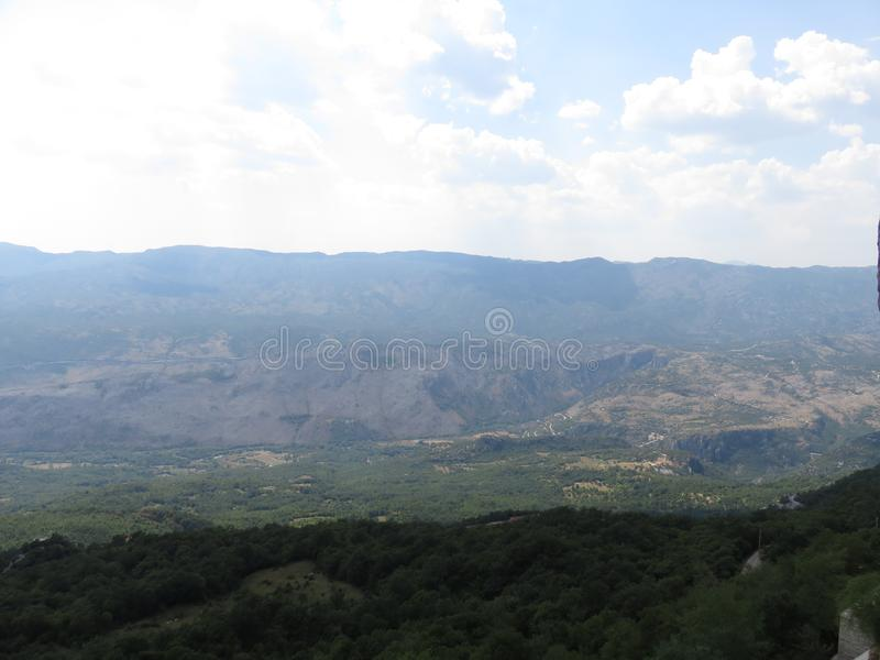 Mountain green valley and distant mountain range. During the summer, this otherwise very rough and cold area takes on paradise royalty free stock images