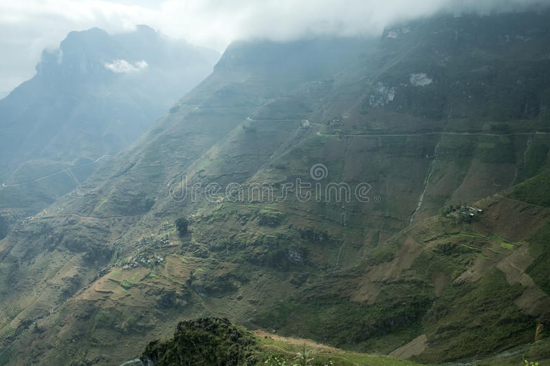 Mountain and Happy road at Ma Pi Leng. In Van stone. Van Stone Plateau (natural or painted Van) is a rocky plateau spread over four districts of Quan Ba, Yen royalty free stock photo