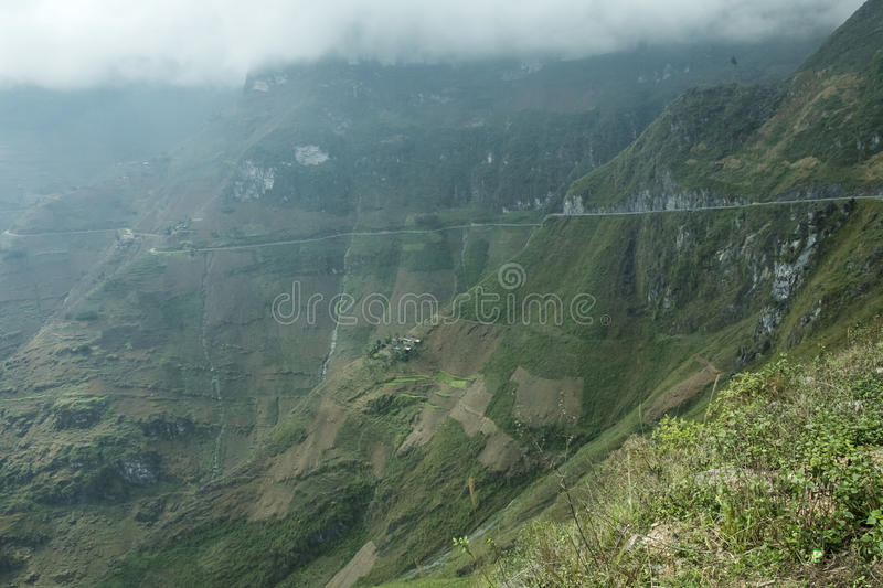 Mountain and Happy road at Ma Pi Leng. In Van stone. Van Stone Plateau (natural or painted Van) is a rocky plateau spread over four districts of Quan Ba, Yen stock photo