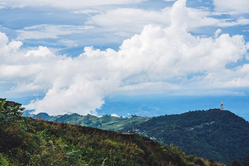 The mountain has a natural green tree in the rainy season and foggy blue sky in Thailand at Phu Tupberk royalty free stock photos
