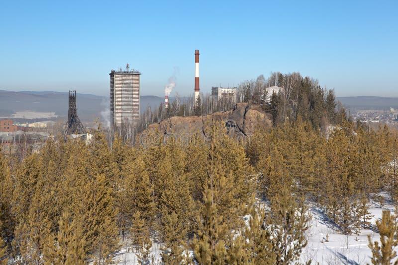 Mountain High and mine Magnetitovaya. Nizhny Tagil. Sverdlovsk region. Russia. Mine Magnetitovaya - iron ore mine in the city of Nizhny Tagil (Sverdlovsk region stock photos