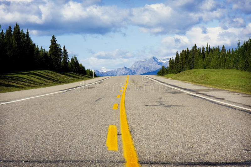 Mountain High way. Photo of a mountain high way with mountains and trees stock photography