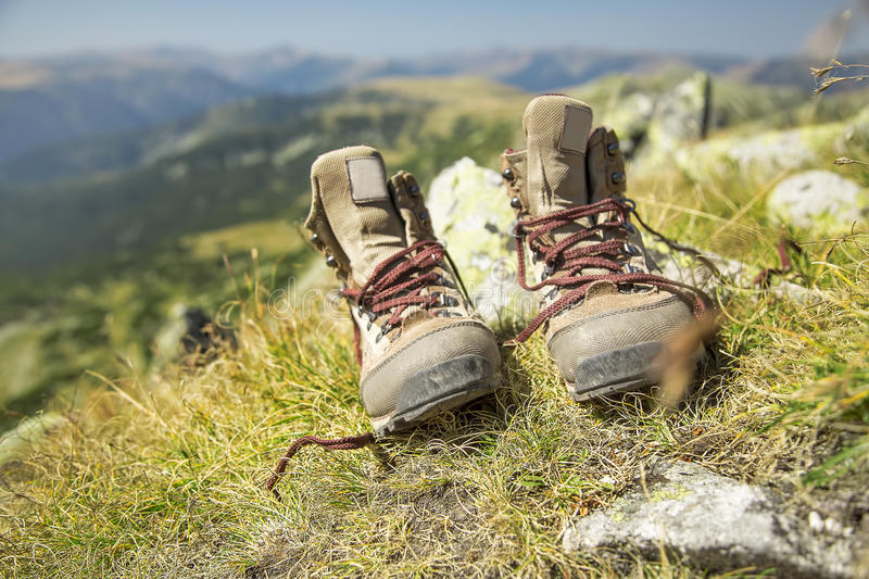Mountain Hiking Boots. In the Summer Grass Outdoor stock photography