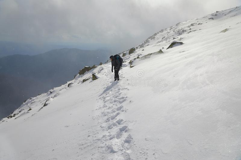 Mountain hiking in snow stock image