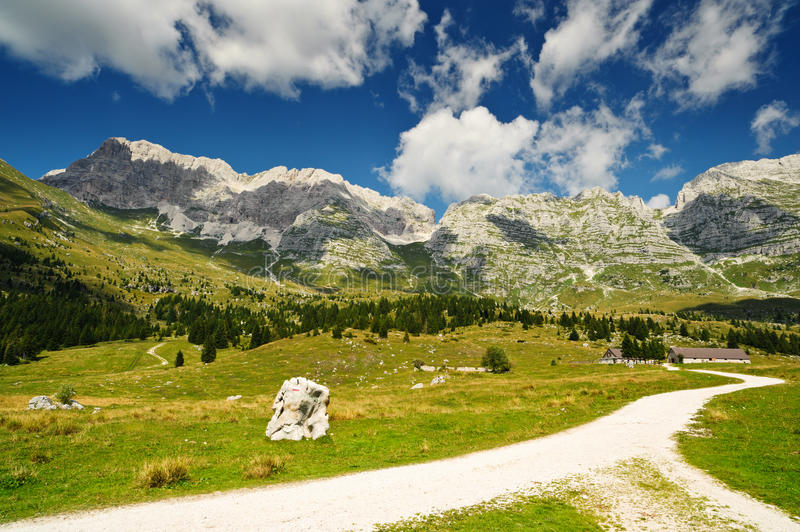 Mountain hiking trail. In Montasio plateau, Sella Nevea, Italy royalty free stock images