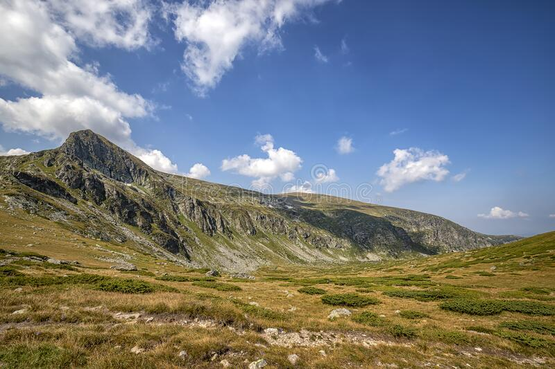 Mountain hill and clouds, Rila mountain, Bulgaria. Beauty landscape of the mountain hill and clouds, Rila mountain, Bulgaria stock photography