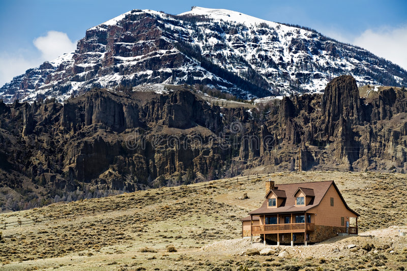 Mountain home. House in the mountains newly constructed stock image