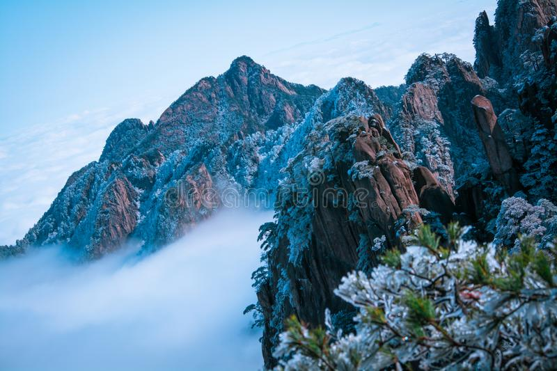 Mountain Huang after snow in winter. With snow covered and clouds stock image