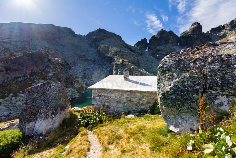Mountain hut chalet refuge lake royalty free stock photos