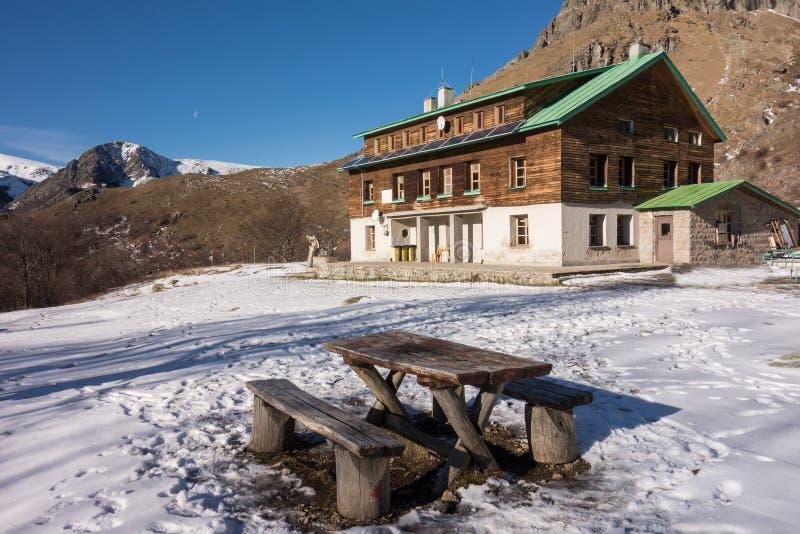 Mountain hut near raisko praskalo waterfall and Botev peak. Central balkan national park, Stara planina mountain, Bulgaria stock photography