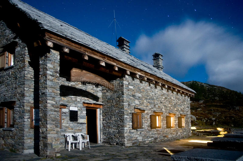 Mountain hut by night. Alpine mountain hut by night stock photography