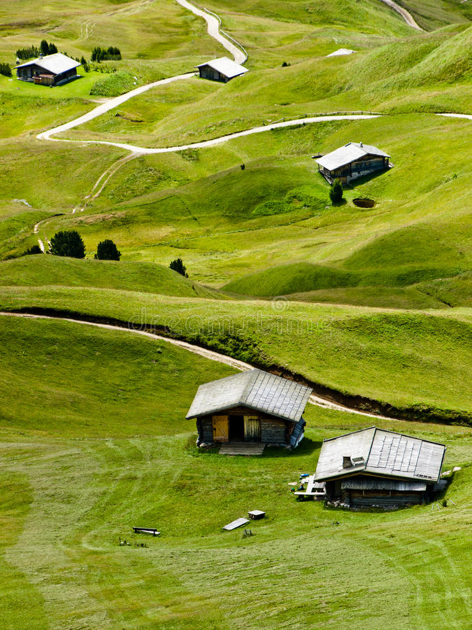 Mountain huts. Surrounded by green grass. Picture taken on Italian Alps (Dolomites royalty free stock photography