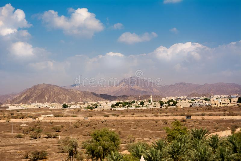 Mountain Jebel Shams and at the base the city of Bahla royalty free stock photo