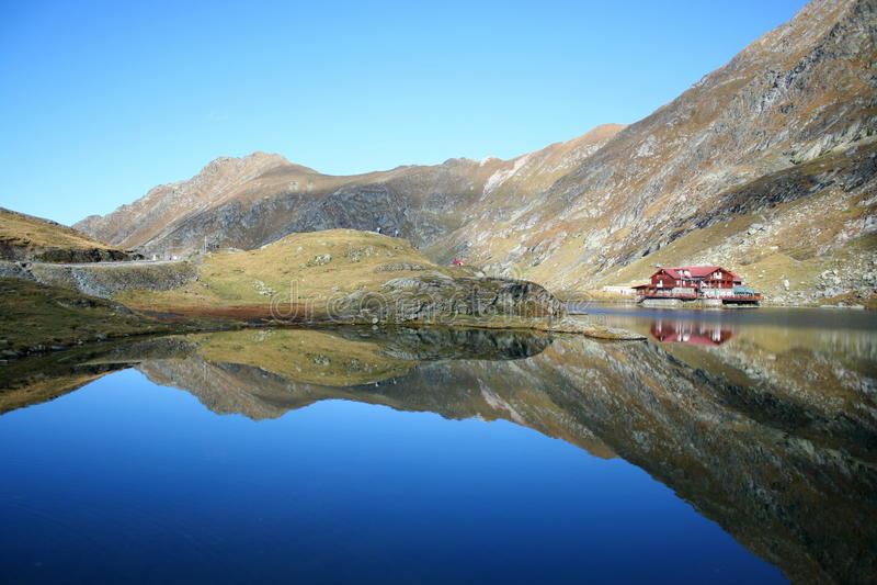 Mountain lake. The lake Balea Lac in the mountains of Romania stock image