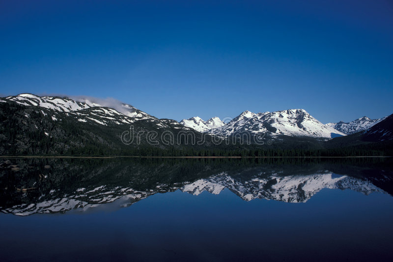 Mountain lake. Lake Lindeman Coast Mountains, B.C., Canada stock photography