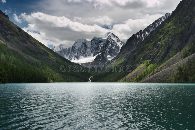 Mountain lake. Sunny day at the mountain lake royalty free stock photo
