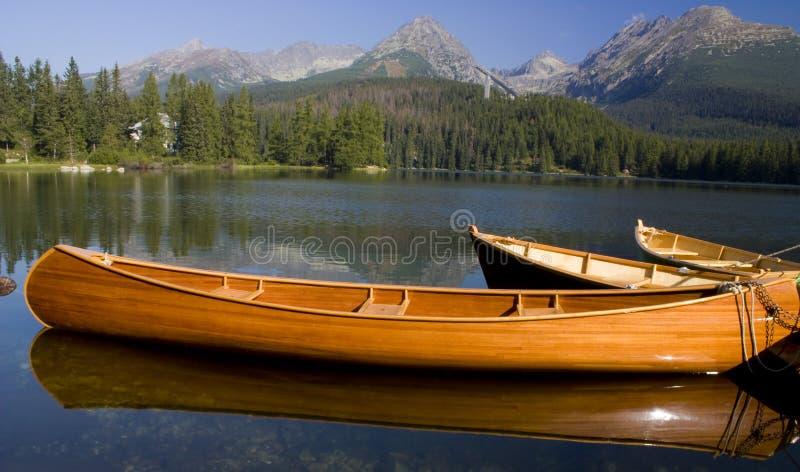 Mountain lake. With boats in National Park High Tatra, Slovakia royalty free stock photography
