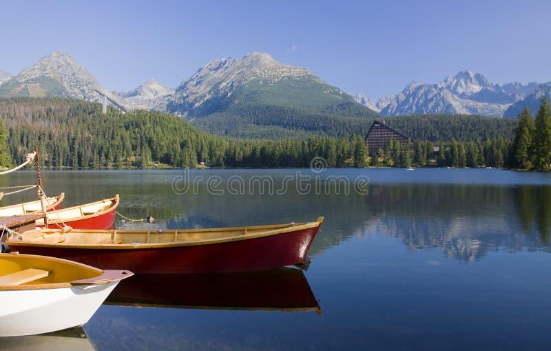 Mountain lake. With boats in National Park High Tatra, Slovakia royalty free stock photos