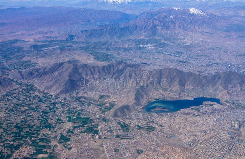 Aerial landscape view, kabul Afghanistan. Mountain, lake, agriculture and city view of Kabul, Afghanistan. Geographic and topographic view are hard and harsh to royalty free stock photos