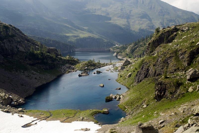 Mountain lake on Alps royalty free stock photos