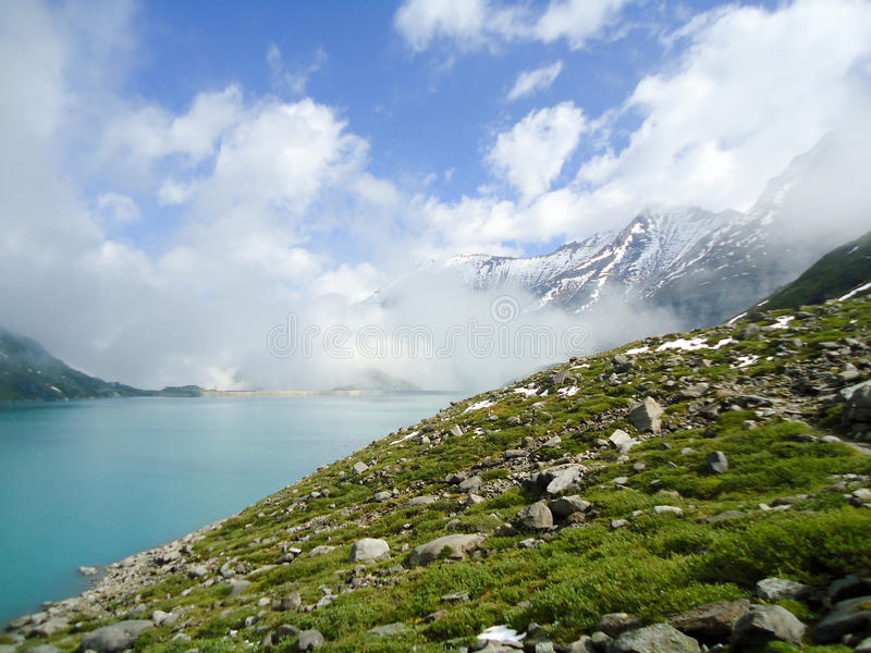 Mountain lake in the alps stock photography
