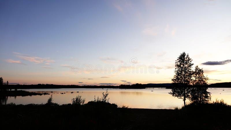 Sunset at Lake Hornavan near Arjeplog in summer in Lapland, Sweden royalty free stock photo