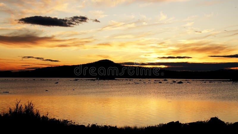 Sunset at Lake Hornavan near Arjeplog in summer in Lapland, Sweden royalty free stock images