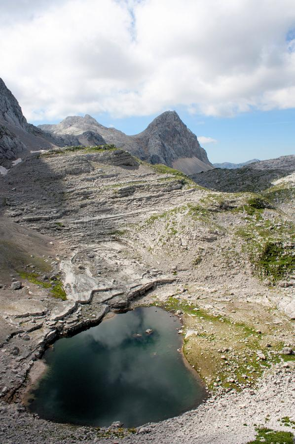 Mountain lake. At the background mighty mountains Slovenia stock photography