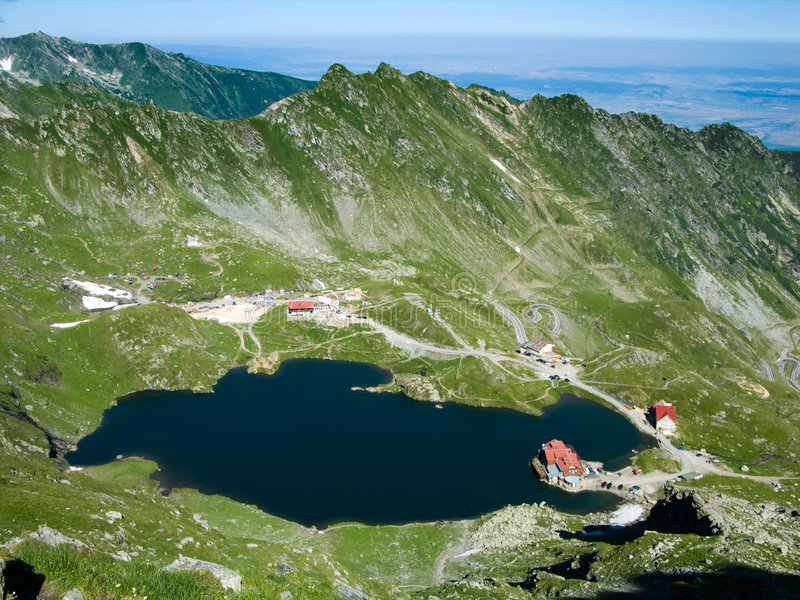 Mountain Lake Balea in Romania. Lake Balea is one of the well known places in romanian Carpathian mountains. Is located in Transylvania, at 2040 meters altitude stock images