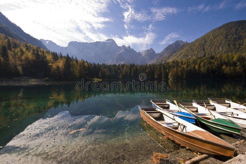 Mountain Lake Boat. Rental boats with mountain lake landscape in a sunny day at Fusine lake - Tarvisio, Italy 2007 stock images